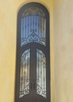 Cathedral style wrought iron door in Huntington Beach, CA