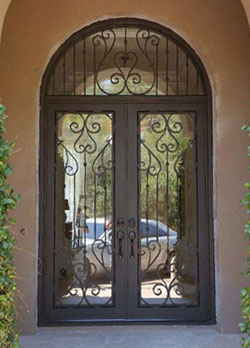 Arched ornamental iron entry door in Coto de Caza