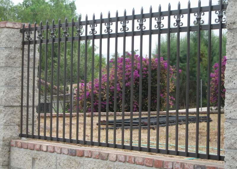 Masonry Property Fence with Iron Topper